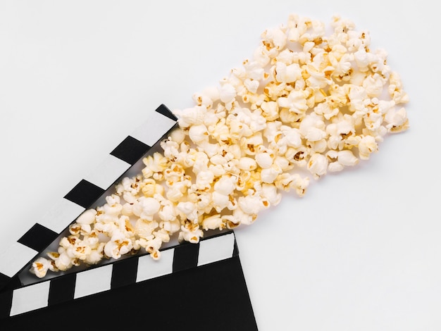 Delicious salted popcorn with movie clapperboard