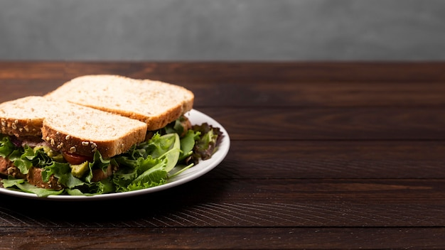 Delicious sandwich on wooden table