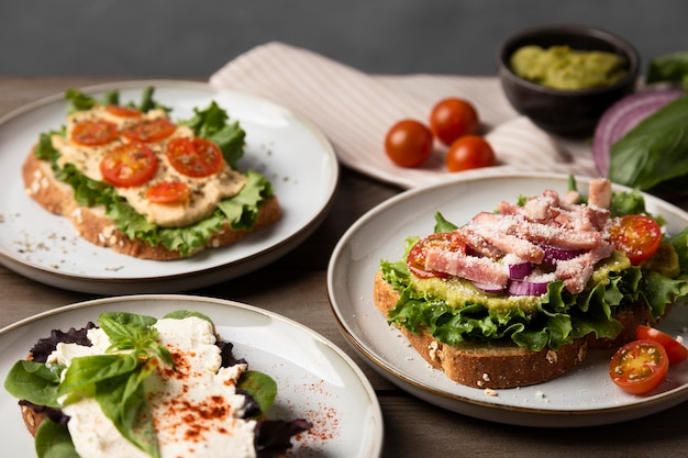Delicious sandwiches on plates high angle