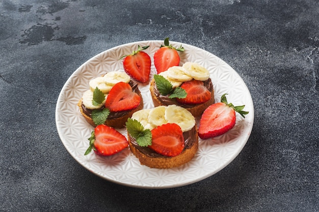 Delicious sandwiches with chocolate nougat, strawberry and banana.