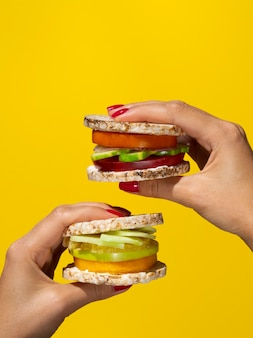 Delicious sandwiches with fruits and vegetables