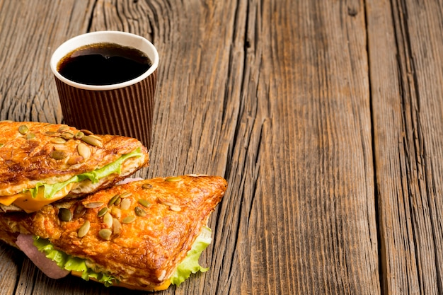 Delicious sandwiches with soda in cup