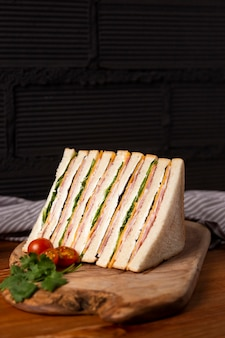 Delicious sandwiches on wooden board