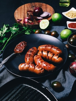 Delicious sausages on frying pan