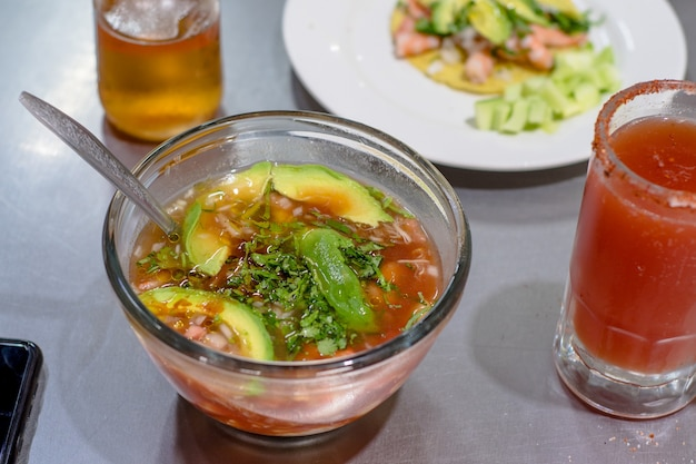 Delicious seafood cocktail with avocado bowl.