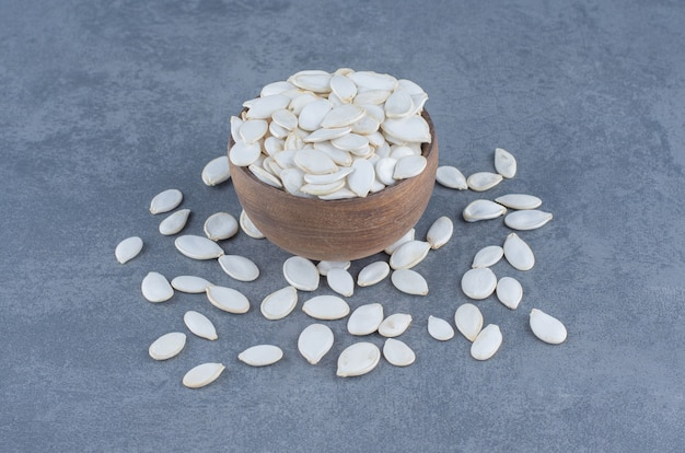 Delicious seeds in the bowl , on the marble background.