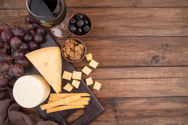 Delicious selection of cheese with grapes and wine