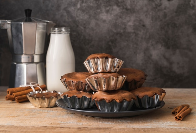 Delicious set of muffins with milk