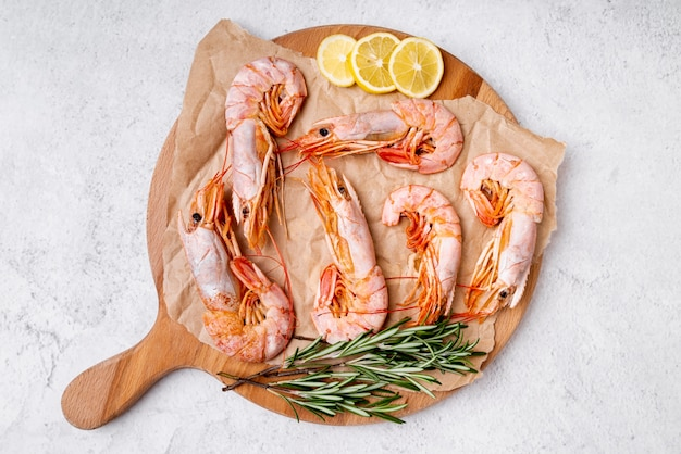 Delicious shrimps on wooden board