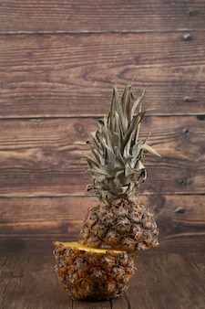 Delicious sliced fresh pineapple placed on wooden surface.