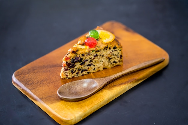 Delicious sliced fruit cake with mixed fruit  on grate and fubric
