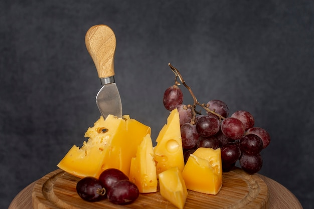 Delicious slices of cheese with grapes