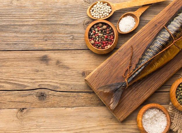 Delicious smoked fish on wooden board