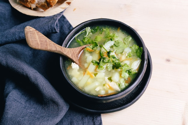 Delicious soup on black bowl