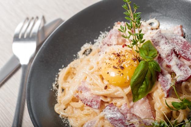 Delicious spaghetti pasta cook with crispy bacon serve