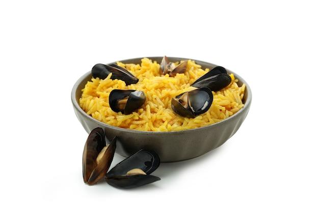 Delicious spanish paella isolated on white background