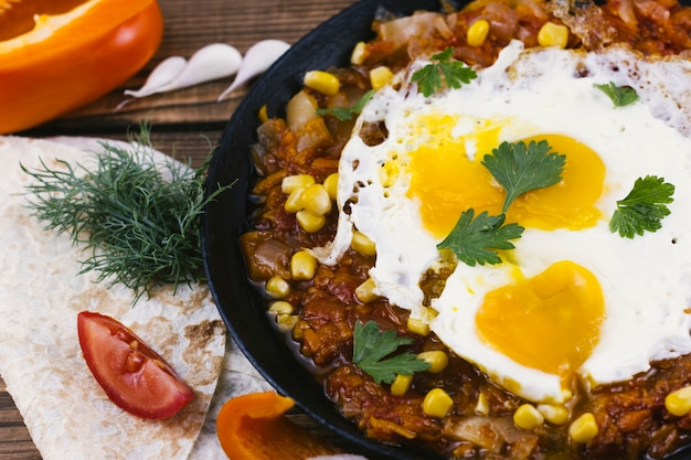Delicious spicy mexican food with fried eggs