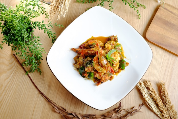 Delicious stir-fry shrimp on the plate