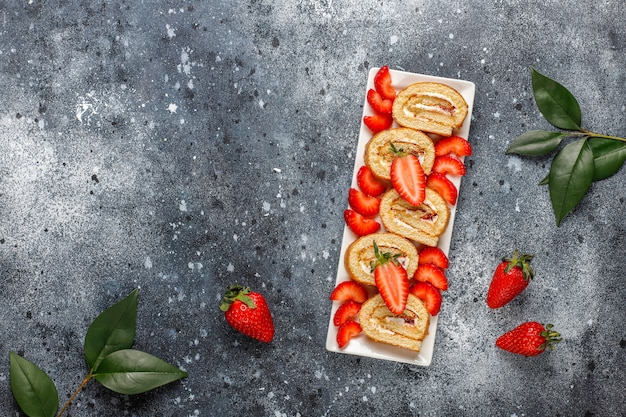 Delicious strawberry cake roll with fresh strawberries,top view