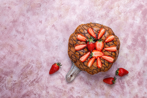 Delicious strawberry chocolate cake with fresh strawberries,top view