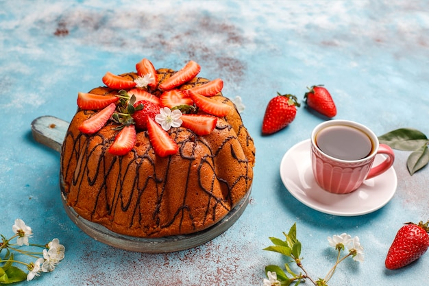 Delicious strawberry chocolate cake with fresh strawberries, top view