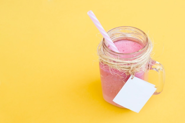 Delicious strawberry smoothie with straw and label for mock up with space on the right