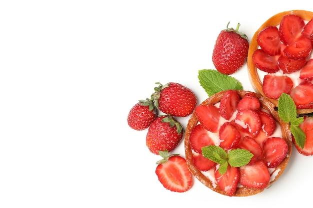 Delicious strawberry tarts isolated on white background.