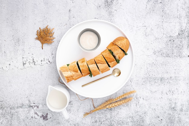 Delicious stuffed french baguette with garlic sauce