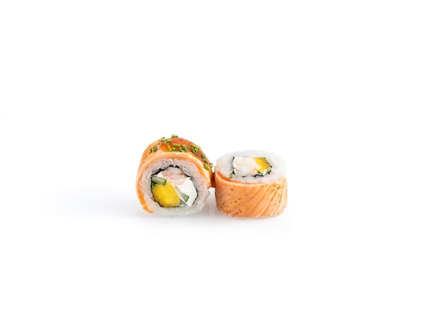 Delicious sushi pieces on a white background