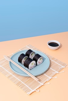 Delicious sushi on plate with chopsticks