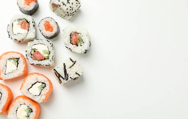 Delicious sushi rolls on white surface. japanese food