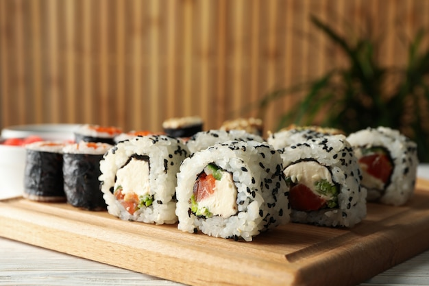 Delicious sushi rolls on wooden table, close up. japanese food