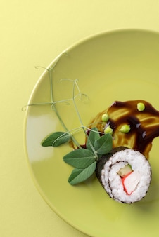 Delicious sushi with plant on plate