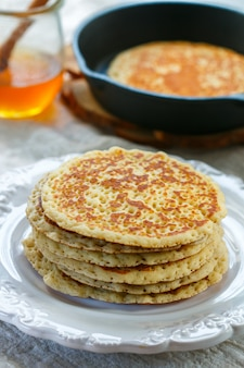 Delicious sweet american pancakes with honey