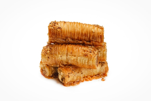Delicious sweet baklava isolated on white surface. top view.