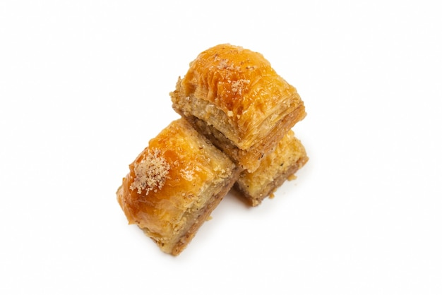 Delicious sweet baklava isolated on white wall. top view.