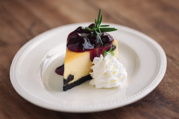 Delicious and sweet blueberry new york cheesecake with whipped cream. homemade bakery  cake.