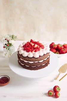 Delicious and sweet cake with strawberries and baiser on a plate