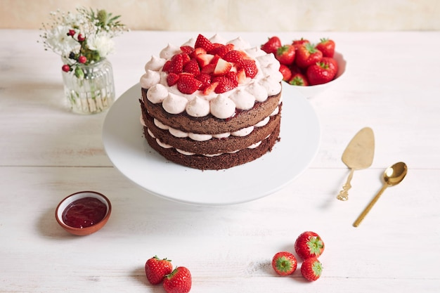 Delicious and sweet cake with strawberries and basier on a plate