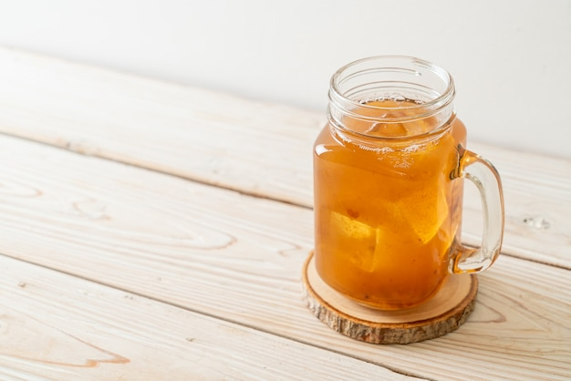 Delicious sweet drink tamarind juice and ice cube - healthy drink style