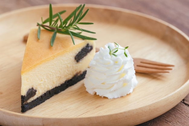Delicious and sweet original plain new york cheesecake on wooden plate served