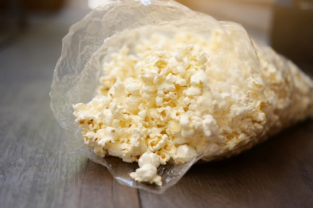 Delicious sweet popcorn in plastic bags.