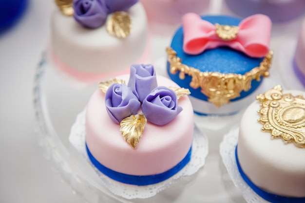 Delicious sweets on wedding candy buffet with desserts