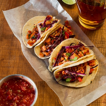 Delicious tacos with sauce arrangement