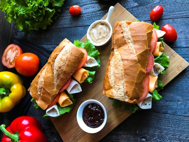 Delicious and tasty sandwiches with turkey, ham, cheese, tomatoes