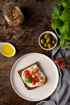 Delicious toast slice with cherry tomatoes flat lay