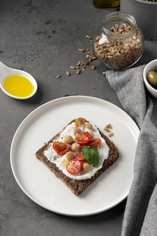 Delicious toast slice with cherry tomatoes high view