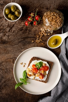 Delicious toast slice with cherry tomatoes and seeds