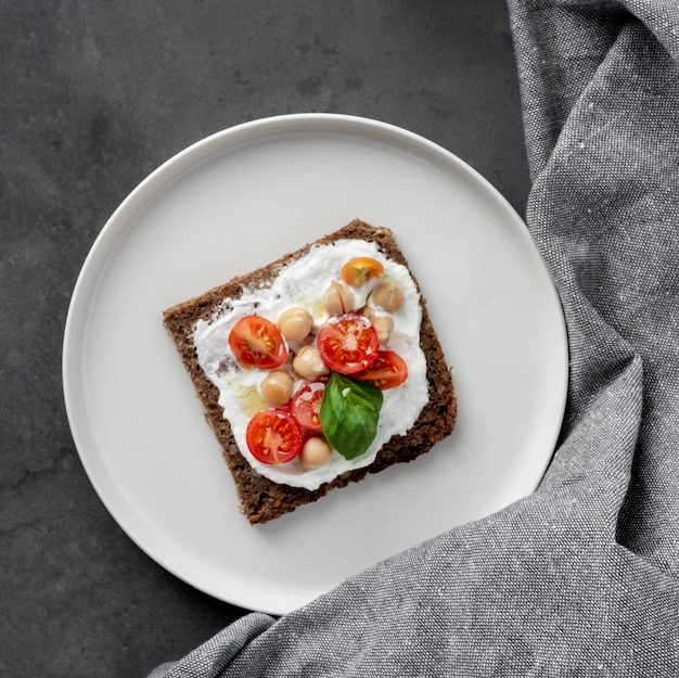 Delicious toast slice with cherry tomatoes