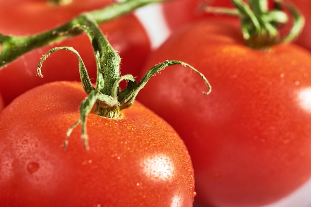 Delicious tomatoes on a chopping board, summertime